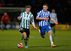 Jarrett Rivers of Blyth Spartans is challenged by Michael Woods of Hartlepool United - Photo mandatory by-line: Rogan Thomson/JMP - 07966 386802 - 05/12/2014 - SPORT - FOOTBALL - Hartlepool, England - Victoria Park - Hartlepool United v Blyth Spartans - FA Cup Second Round Proper.