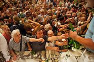 Roma 30 Luglio 2012..Venerabile Arciconfraternita del SS.mo Sacramento e di Maria Ss. del Carmine in Trastevere a Roma fondata nell' anno 1539. I Solenni Festeggiamenti e la processione in onore della Madonna Fiumarola.La distribuzione delle rose benedette.The Solemn Celebrations and processions in honor of Madonna Fiumarola..http://www.arciconfraternitadelcarmine.it.http://eternallycool.net/?p=285.