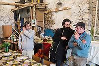 CETARA, ITALY - 10 March 2014: Daniele De Michele (center) interviews Antonio Polverino, a 64 years old peasant,  in his farmhouse after a lunch with local products, in Cetara, a village of fishermans in the Amalfi Coast, Italy, on March 10th 2014.<br /> Antonio Polverino was interviewed by Daniele De Michele, aka Donpasta, a DJ-economist with a passion for gastronomy.