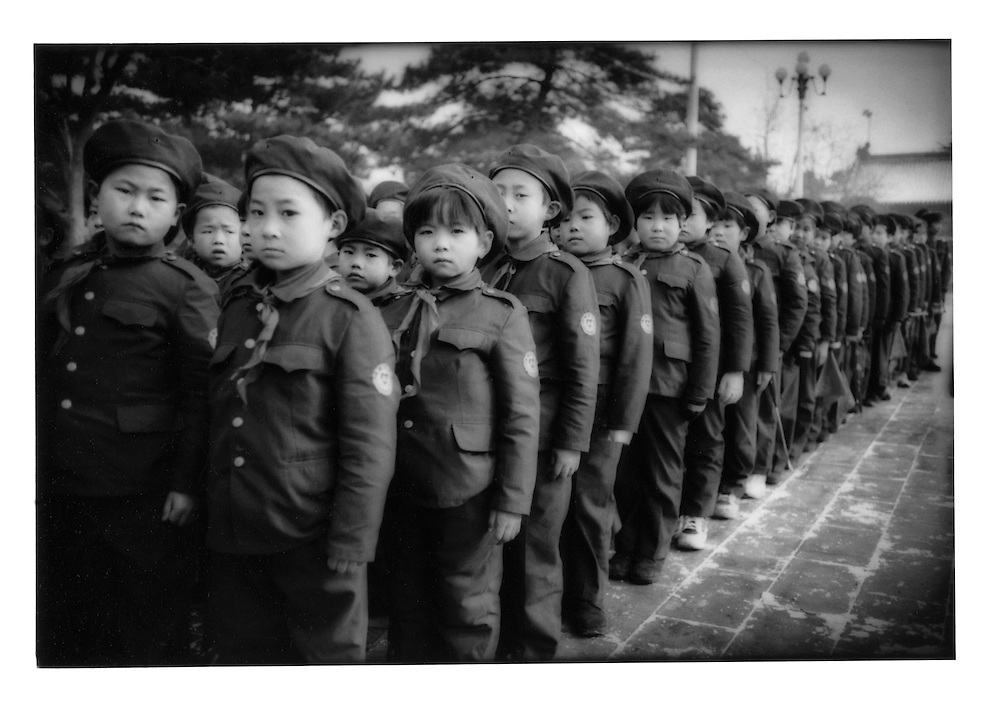 Uniformed students brave the winter cold while standing in formation inside Tiananmen Gate.  Beijing, China.  2000