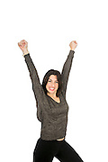 success. Smiling young woman raises her arm On white Background