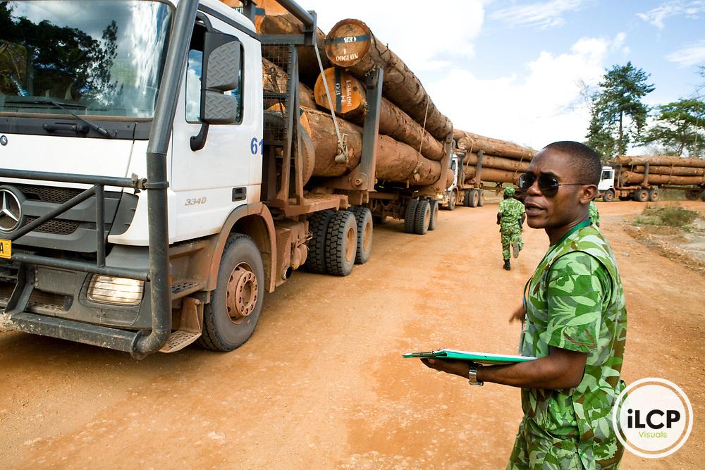 National Park guard checking logging trucks for legal harvest, Lope National Park, Gabon