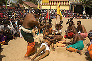 The Four Guardians arrive at the front of the main Vishnu Kovil. The fire walking will take place here the next day. Each is given charge of a corner. They dance to Sinhalese drummers. Each finally falls at his respective corner, is whipped, and then carried off into the temple.