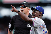 BOSTON, MA - AUGUST 8: Texas Rangers manager Ron Washington points to the foul pole as he talks to third base umpire Lance Barrett following a questionable call during a game against the Boston Red Sox at Fenway Park on August 8, 2012 in Boston, Massachusetts. The Rangers won 10-9. (Photo by Joe Robbins)