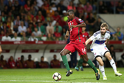 August 31, 2017 - Porto, Portugal - Portugal's midfielder William Carvalho vies with Faroe Islands' midfielder Roaldur Jakobsen during the 2018 FIFA World Cup qualifying football match between Portugal and Faroe Islands at the Bessa XXI stadium in Porto, Portugal on August 31, 2017. (Credit Image: © Pedro Fiuza/NurPhoto via ZUMA Press)