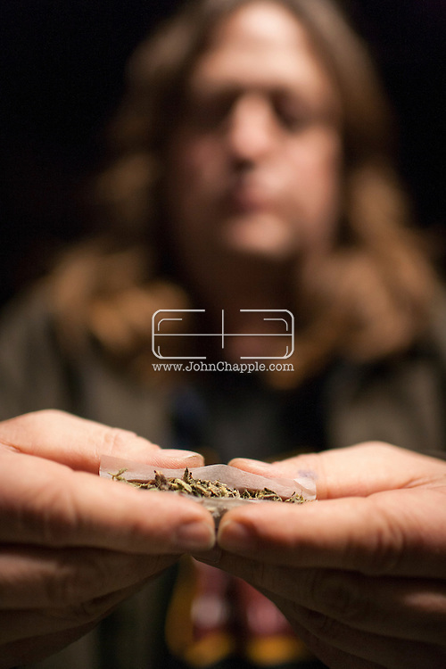 December 6, 2012. Seattle, Washington. Washington and Colorado became the first states to vote to decriminalize and regulate the possession of an ounce or less of marijuana by adults over 21. Pictured at a 'Stash Mob' gathering in Seattle is Matthew Gordon, rolling a marijuana joint in public...Photo © John Chapple / www.JohnChapple.com