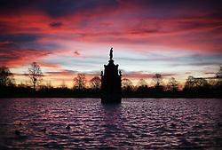 © Licensed to London News Pictures. 28/12/2015. London, UK. Sun rises over the Diana Fountain in Bushy Park. Photo credit: Peter Macdiarmid/LNP