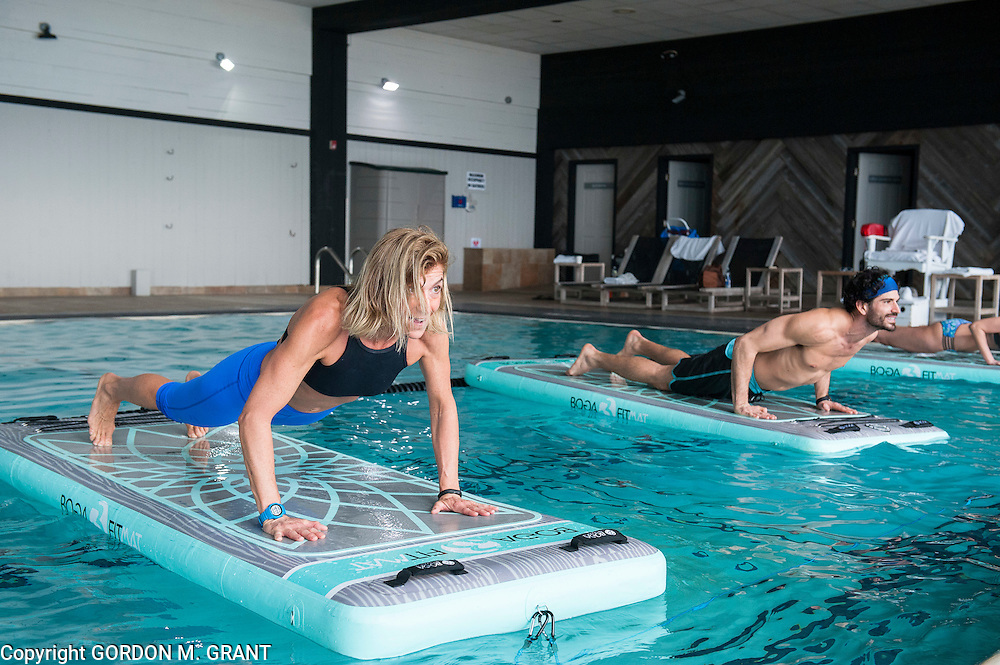 Gina Bradley, left, owner of Paddle Diva, teaches a Pool Mat Fitness class in the pool area at Gurney's Montauk Resort & Seawater Spa in Montauk, Feb. 7, 2017. Chris Tagliavia is at right.
