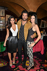 Left to right, KIM KARDASHIAN WEST, ALI FATOURECHI and LIBERTY ROSS at a dinner to celebrate the launch of Genetic - Liberty Ross hosted by Liberty Ross and Ali Fatourechi at Annabel's, 44 Berkeley Square, London on 3rd September 2014.