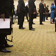 Job seekers wait to speak to a various companies and recruiters at a job fair at the Rosslyn Holiday Inn in Arlington, VA on Friday, Jan. 15, 2010.