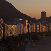 Praia de Copacabana at sunrise. Copacabana beach, one of the world's most famous urban beaches at sunrise. The beach and hotel strip stretches for 1.5 miles (4km) from the Morro do Leme at the Northern end, to Arpoador. Copacabana beach, Rio de Janeiro,  Brazil. 21st July 2010. Photo Tim Clayton..