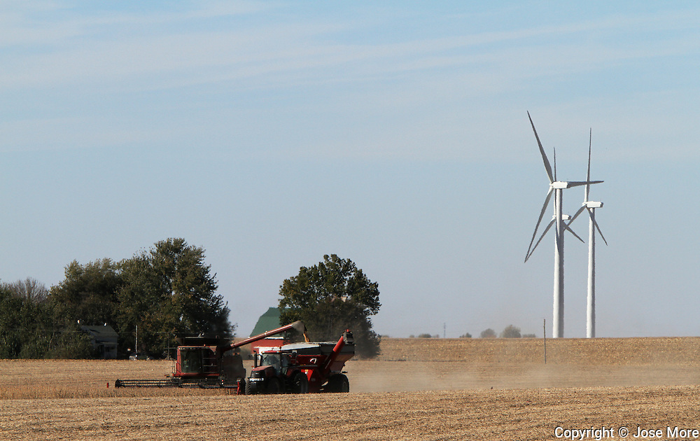 A farmer harvest soy beans among<br /> power generating wind farms near Bloomington, in central Illinois<br /> Photography by Jose More