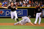 PHOENIX, AZ - APRIL 30:  Nick Ahmed #13 of the Arizona Diamondbacks turns the double play over the sliding Nick Hundley #4 of the Colorado Rockies in the second inning at Chase Field on April 30, 2016 in Phoenix, Arizona.  (Photo by Jennifer Stewart/Getty Images)