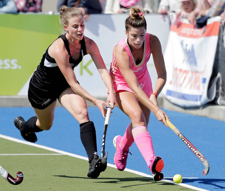 Argentina's Agustina Albertarrio, right, chased by New Zealand Black Stick Shiloh Gloyn in a International hockey test, Blenheim, New Zealand, Saturday, October 03,  2015.  Credit:SNPA / Anthony Phelps