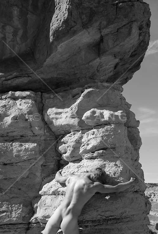 nude man and rock formations in Abiquiu, New Mexico