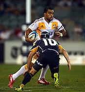 Liam Messem takes on Matt Giteau.Super 14 rugby union match, Brumbies v Cheifs, Canberra, Australia. Saturday 19 February 2011. Photo: Paul Seiser/PHOTOSPORT.../SPORTZPICS