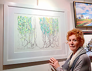 Manhasset, New York, U.S., April 7, 2017. LINDA LOUIS stands next to her mixed media art at Reception for The Art Guild exhibition is held at Elderfields Preserve.