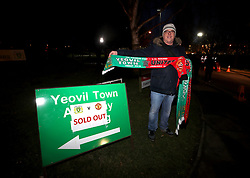 A vendor sells half and half scarves outside the ground before the Emirates FA Cup, fourth round match at Huish Park, Yeovil.
