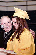 Alter president Rev. James Manning (left) and Megan Winter during the 47th commencement excercise of Archbishop Alter High School at Trent Arena in Kettering, Saturday, May 26, 2012.