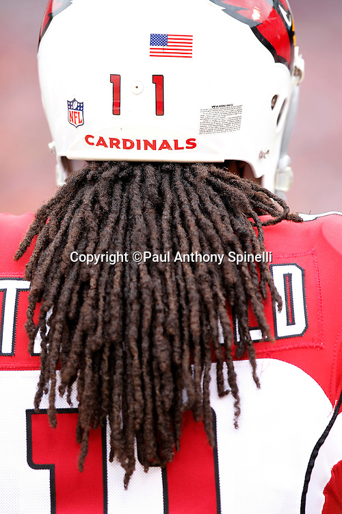 Arizona Cardinals wide receiver Larry Fitzgerald (11) watches the defense at work while his hair hangs out of his helmet during the NFL week 17 football game against the San Francisco 49ers on Sunday, January 2, 2011 in San Francisco, California. The 49ers won the game 38-7. (©Paul Anthony Spinelli)