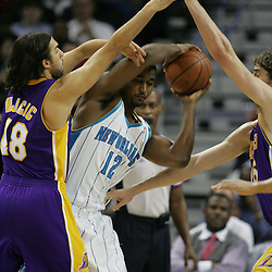 23 December 2008:  New Orleans Hornets center Hilton Armstrong (12) fights off a double team from Lakers defenders Sasha Vujacic (18) and Pau Gasol (16) during a 100-87 loss by the New Orleans Hornets to the Los Angeles Lakers at the New Orleans Arena in New Orleans, LA. .