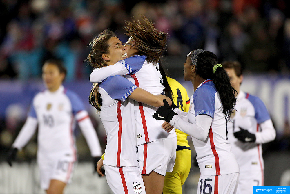 Mallory Pugh, (center), USA, is congratulated by team mates Tobin Heath, (left) and Crystal Dunn after scoring a goal during the USA Vs Colombia, Women's International friendly football match at the Pratt & Whitney Stadium, East Hartford, Connecticut, USA. 6th April 2016. Photo Tim Clayton