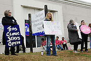 "1/22/13/  Jackson MS -Pictured are supporters of the Pro-Choice movement and the Jackson Women's Clinic on the 40th Anniv. of Roe-v-Wade. Governor Bryant is attempting to close the clinic by making strict laws for the clinic and having the doctors have admitting privileges at local hospitals. The clinic is unable to comply with State law and is fighting to stay open. Governor Phil Bryant joins the PLAN (Pro Life America Network) and speaks at the Mississippi State capital in support of his Pro Life agenda on the 40th Anniversary of Roe-v-Wade. Governor Bryant asked  for people to ""pray for the unborn babies"" and Bryant is pushing hard to close the States only operating Abortion Clinic. Photo© Suzi Altman"