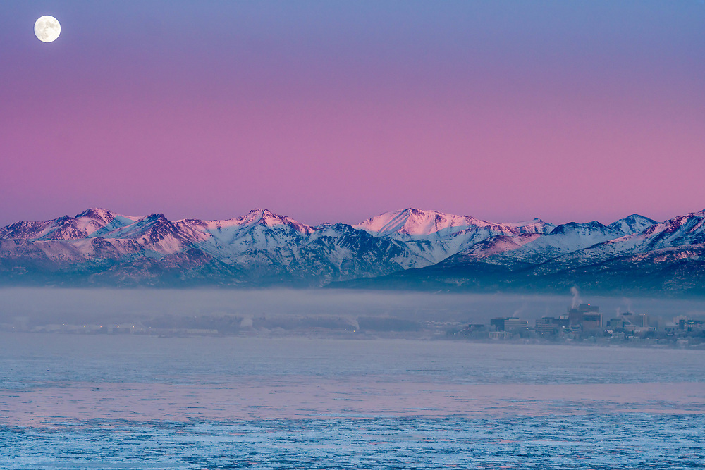 I hiked out in the fog in hopes to catch the moon coming up from behind the Chugach mountains. The fog cleared out not in time to get my planned shot but this will do.