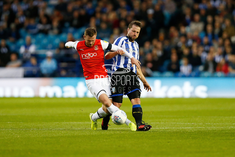 Julian Börner of Sheffield Wednesday challenges Andrew Shinnie of Luton Town during the EFL Sky Bet Championship match between Sheffield Wednesday and Luton Town at Hillsborough, Sheffield, England on 20 August 2019.