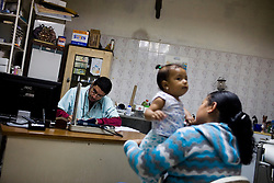 Dr. Carlos Serrano at his clinic  in Petare, one of the largest and most dangerous slums of Caracas.  Pfizer is trying to increase their market share in the slums and are targeting clinics, hospitals and pharmacies, sending sales representatives to the far reaches of the slum. Dr. Serrano receives regular sales calls from Pfizer.