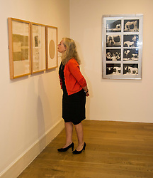 Pictured: Journalist Susan Nickalle gets up close and personal to some of Joseph Beuys less known work<br /> The Richard Demarco &amp; Joseph Beuys A Unique Partnership exhibition examines the collaboration between the avant-garde gallerist and German post-war artist. The exhibition is open to the public between  30 July and 1 October 2016<br /> <br /> Ger Harley | EEm 28 July 2016