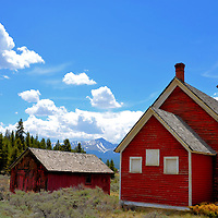 """Old Malta Little Red Schoolhouse and Rocky Mountains near Leadville, Colorado<br /> Leadville is noted for its high elevation (over 10,000 feet), the start of Colorado's Silver Boom and the death of Buffalo Bill Cody. Just after leaving the """"Two-Mile-High City's"""" historic district and before reaching Malta, you are treated to this picturesque scene. In the background of this abandoned, little red school house is Mount Massive. At 14,428 feet, it is the Rocky Mountains' second highest peak."""