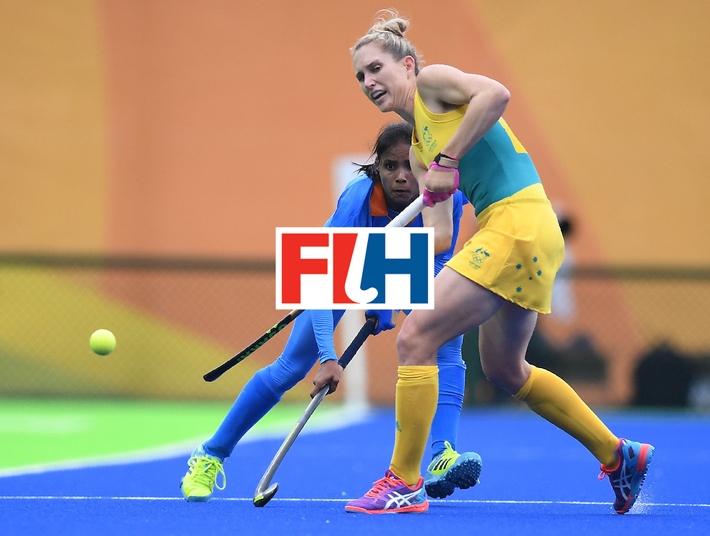 India's Vandana Katariya (L) vies for the ball with Australia's Kirstin Dwyer during the women's field hockey India vs Australia match of the Rio 2016 Olympics Games at the Olympic Hockey Centre in Rio de Janeiro on August, 10 2016. / AFP / MANAN VATSYAYANA        (Photo credit should read MANAN VATSYAYANA/AFP/Getty Images)