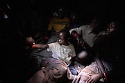 Whole families are awoken as UNHCR carry out registration of displaced persons at the Bulengo IDP site in Goma, DRC, on Wednesday, Feb. 6, 2008. The registration is carried out without warning in the middle of the night in order to prevent outsiders from trying gain the benefits of IDP status.