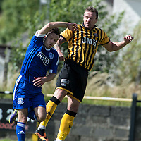 Picture by Christian Cooksey/CookseyPix.com.<br /> All rights reserved. For full terms and conditions see www.cookseypix.com<br /> <br /> Juniors - Auchinleck Talbot v Glenafton Athletic. Auchinleck's Mark Campbell beats Glenafton's Mick McCann to the header.