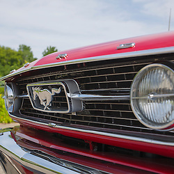 A close-up of the grille of a 1966 Ford Mustang 289 convertible.
