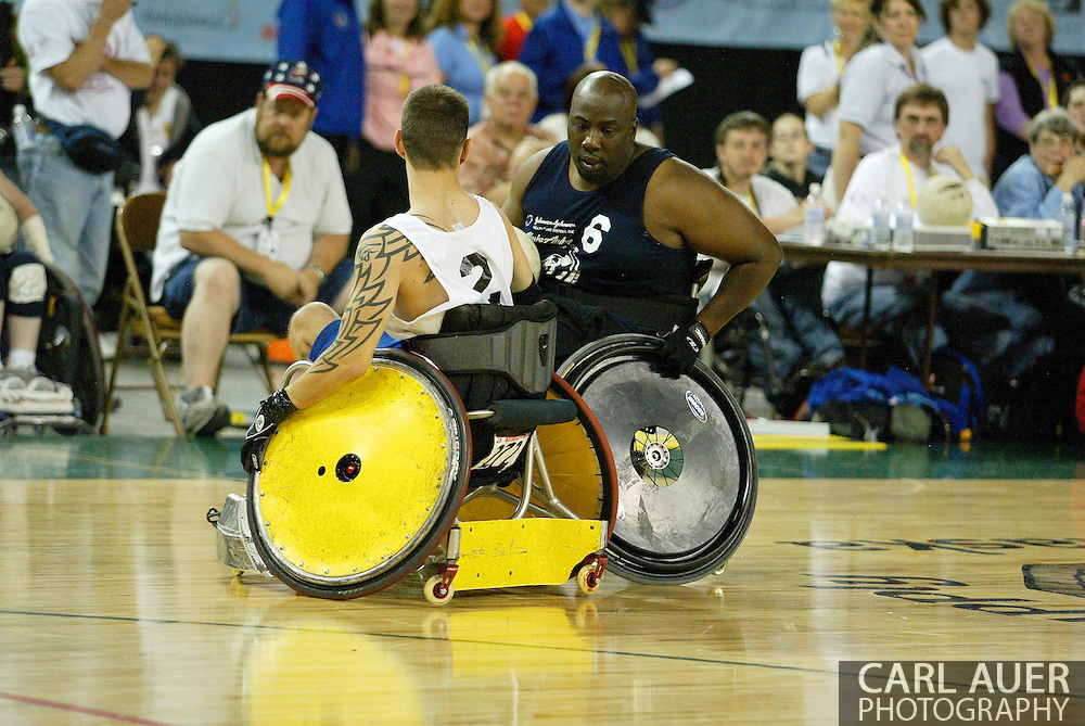 July 7th, 2006: Anchorage, AK - Johnny Holland (6) gets cut off by Michael Schecherbauer (2) as White defeated Blue in the gold medal game of Quad Rugby at the 26th National Veterans Wheelchair Games.