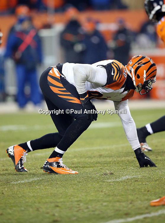 Cincinnati Bengals defensive end Michael Johnson (90) gets set in a three point stance during the 2015 NFL week 16 regular season football game against the Denver Broncos on Monday, Dec. 28, 2015 in Denver. The Broncos won the game in overtime 20-17. (©Paul Anthony Spinelli)
