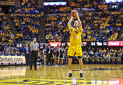 Dec 8, 2018; Morgantown, WV, USA; West Virginia Mountaineers guard Chase Harler (14) shoots a foul shot after a technical foul was assessed against the Pittsburgh Panthers at WVU Coliseum. Mandatory Credit: Ben Queen-USA TODAY Sports