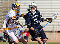 A Chaparral High School lacrosse player loses the ball as a Temecula Valley defender strikes him in a Varsity match-up between two cross town rivals.  Image Credit: Amanda Schwarzer