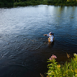 A woman fly-fishing on the Connecticut River in Clarksville, New Hampshire.