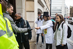 London, UK. 22 November, 2019. Climate activists from Scientists for XR, including Dr Emily Grossman (r), deliver a letter to the Department for Education during a demonstration intended to communicate the science relating to the climate and ecological emergency. Activists were dressed in labcoats to represent the 1600 scientists worldwide who have signed the Scientists Declaration in support of non-violent direct action against government inaction against the climate and ecological emergency.