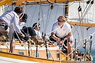 Tim Blackman, Admiral of the British Classic Yacht Club crewing on Barney Sanderman's Laughing Gull during the Panerai British Classic Sailing Week regatta.<br /> Picture date: Monday July 10, 2017.<br /> Photograph by Christopher Ison &copy;<br /> 07544044177<br /> chris@christopherison.com<br /> www.christopherison.com