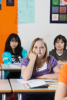 Girl (10-12) with Down syndrome in classroom