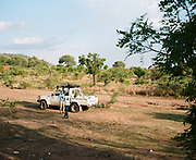 "NUBA MOUNTAINS, SUDAN – JUNE 9, 2018: Aid workers travel from the Yida host community across the Sudan border and through SPLA/M-N controlled territory to reach the Nuba Mountains. <br /> <br /> In 2011, the government of Sudan expelled all humanitarian groups from the country's Nuba Mountains. Since then, the Antonov aircraft has terrorized the Nuba people, dropping more than 4,080 bombs on hospitals, schools, marketplaces and churches. Today, vestiges of the Antonov riddle the landscapes of daily life, where more than 1 million Nuba live in famine conditions – quietly enduring the humanitarian blockade intended to drive them out of the region. The skies are mostly clear. Yet the collective memory of the bombings remains an open wound, and the Antonov itself a persistent threat. So frequent were the attacks that the Nuba nicknamed the high flying aircraft and its dismal hum: ""Gafal-nia ja,"" they would declare, running to the hillsides. ""The loss of appetite has come."""