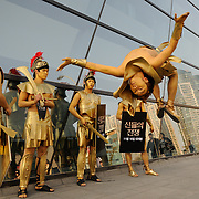 Performers advertise for a film outside the Busan Cinema Center during the 16th Busan International Film Festival, October 8, 2011.