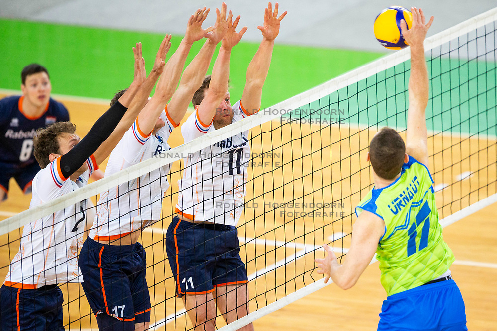 30-12-2019 SLO: Slovenia - Netherlands, Ljubljana<br /> Tine Urnaut of Slovenia and Michaël Parkinson, Jelte Maan of the Netherlands during friendly volleyball match between National Men teams of Slovenia and Netherlands,