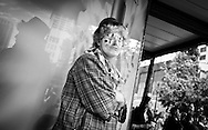 2012 June 24  - A person dressed as a clown on a street corner in downtown Seattle, WA. Photo by Richard Walker