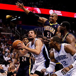 March 11, 2012; Orlando, FL, USA; Orlando Magic power forward Ryan Anderson (33) under the basket as Indiana Pacers power forward David West (21) defends during the first quarter of a game at  Amway Center.   Mandatory Credit: Derick E. Hingle-US PRESSWIRE