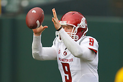 Nov 5, 2011; San Francisco CA, USA;  Washington State Cougars quarterback Marshall Lobbestael (9) warms up before the game against the California Golden Bears at AT&T Park.  California defeated Washington State 30-7. Mandatory Credit: Jason O. Watson-US PRESSWIRE